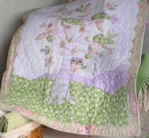 Twit twoo, I love owls. This patchwrk quilt is adorable <3