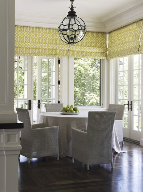 White Breakfast Nook With A Punch Of Color On The Shades