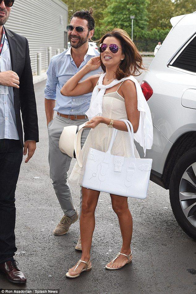 Cute couple: Eva Longoria and boyfriendJose Antonio Baston put in a joint appearance at the US Open on Friday