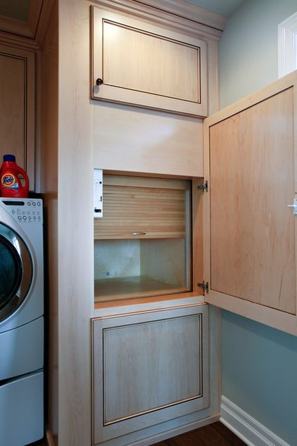A laundry chute by Oglesby Construction Company that incorporates a tambour door to catch falling laundry.