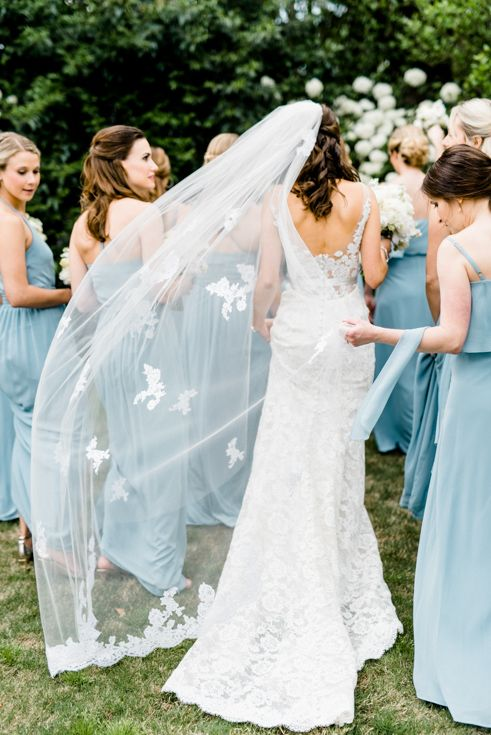Liancarlo wedding dress and Joanna August light blue bridesmaids dresses. Photo by Caroline Lima Photography