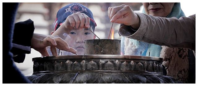 Child in Todai-ji Temple, Nara - Japan by AmnesiArt