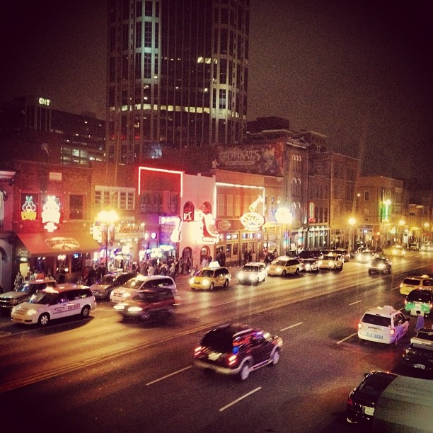 Broadway Street in Nashville lit up at night.  Great spot if you looking to listen to up and coming country music stars.