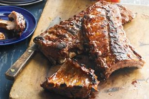Sweet & Hot Sticky Ribs recipe - A quick simmer cuts down on grilling time and preps the ribs to soak up the full flavor of the sauce. Don't forget extra napkins! #ForDad