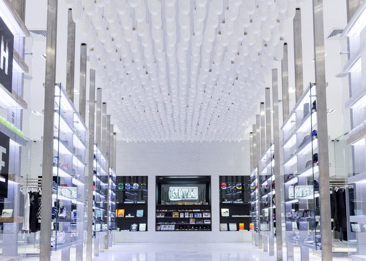 Snarkitecture has designed a Brooklyn store for Kith, including a cereal bar and an installation made from 700 replica Nike Air Jordan II sneakers.