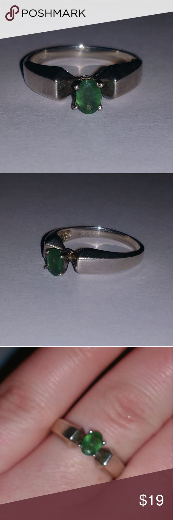 Sterling silver ring with emerald This is a beautiful sterling silver ring with a beautiful emerald stone. it is a size 8.5 Jewelry Rings