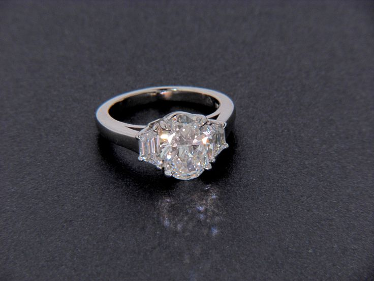 Oval Diamond Ring With Trapezoid Side Stones Three Stone
