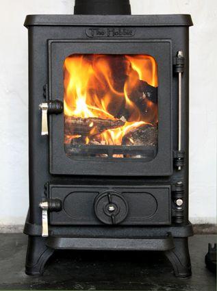 The Hobbit multi fuel stove  http://www.salamanderstoves.com/docs/64/the_hobbit_stove/#