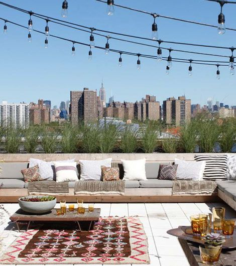 Outdoor terrace with style and string lights? Yes please!