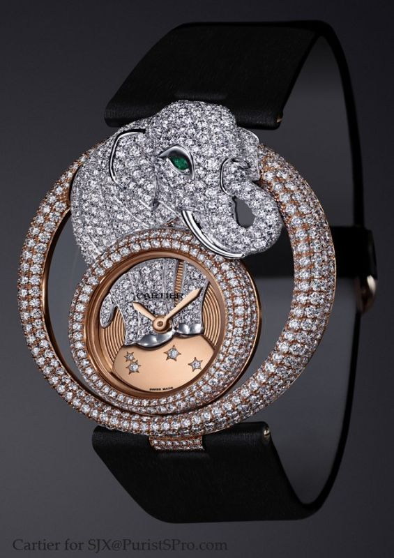 The elephant offers 7.2 carats of diamonds and an emerald for the elephant's eye. The dial is solid gold guilloche set with more diamonds.