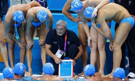 Coming soon to a board game near you. Italy's coach Alessandro Campagna gives instructions to Italy's water polo team ahead of their game against Greece.