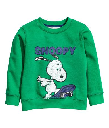 Green/Snoopy. Sweatshirt with a printed design. Ribbing at neckline, cuffs, and hem. Soft, brushed inside.