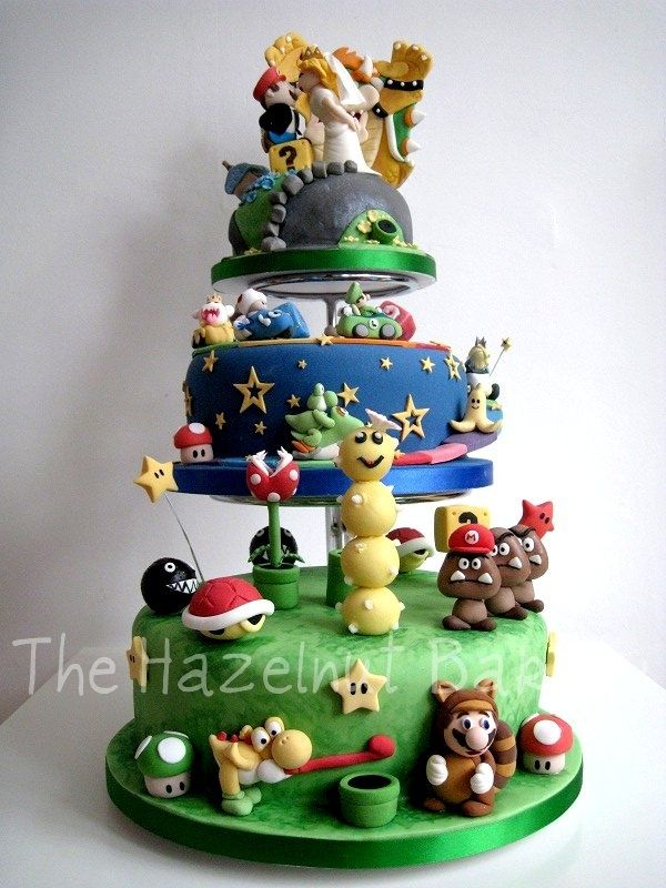 Isn't this one of the awesome-st Super Mario wedding cakes you've ever seen?  If you look at every single detail of this creation you'll realize just how awesome this really is.  I mean, check out where Mario is standing, I'm still giggling over that.