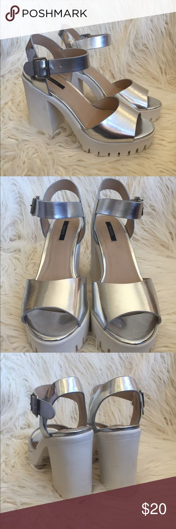 Metallic strappy heels Silver metallic strappy heels from F21! Size 7.5 but I'm a 7 and they fit great. Worn once, some marks on heel of shoe and on bottom, otherwise perfect condition ASOS Shoes Heels