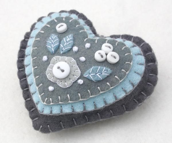 Handmade felt heart ornament with embroidery and applique in blue, grey and white,embellished with tiny buttons. A perfect Christmas gift or decoration . 9cm x 8cm approx, with a cotton loop for hangi