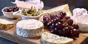 Selection of french cheeses with grapes