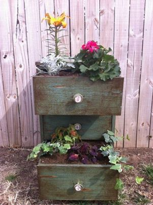recycled dresser now outdoor planter