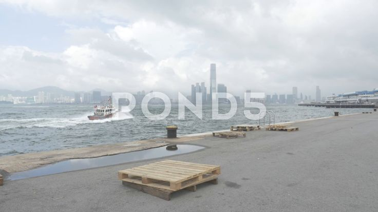 Hong Kong Skyline From Pier Dock Yard Boat Sea - Stock Footage | by RyanJonesFilms