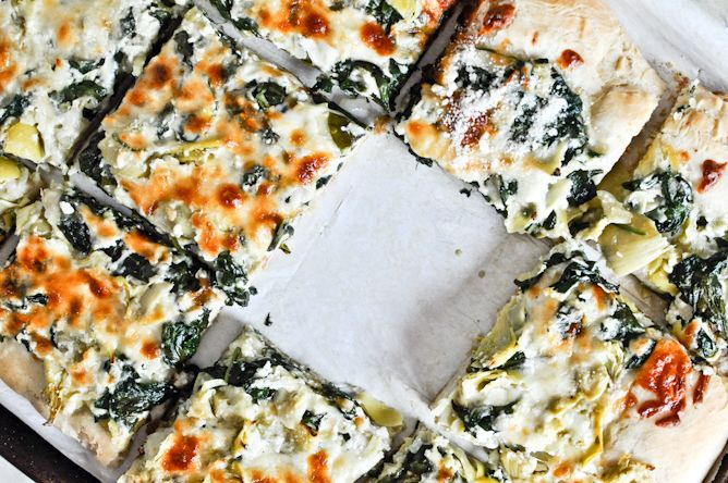 Spinach Artichoke pizza that is AMAZING! I made it this weekend and it was incredibly delicious. I used my own recipe for the crust and I put chicken on top as well