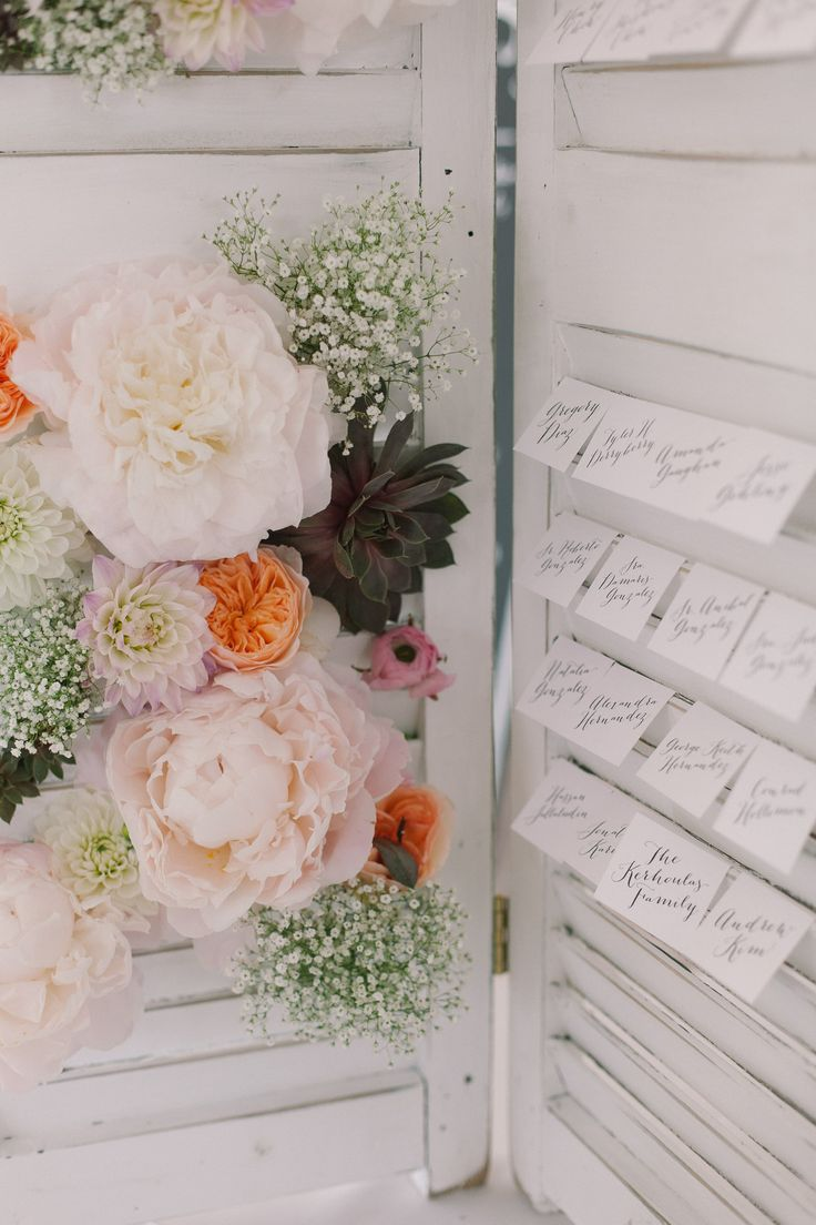 vintage shutter used as a seating card display | Photography: Ruth Eileen Photography - rutheileenphotography.com, Florals by https://www.facebook.com/sweetanniefloral  Read More: http://stylemepretty.com/2013/10/16/newport-wedding-from-ruth-eileen-photography/