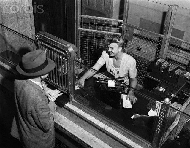 vintage bank window 1940s woman bank teller behind cage. Black Bedroom Furniture Sets. Home Design Ideas