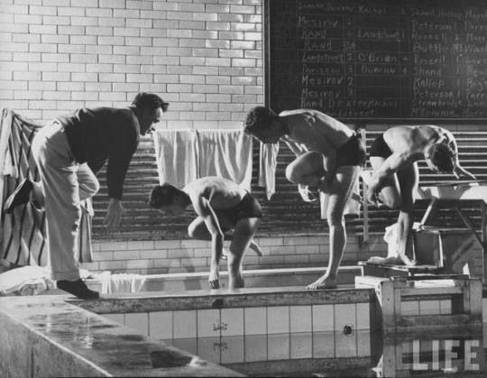 Ph. Gjon Mili - Princeton University, NJ, USA, diving coach Howard Stepp exercising student divers at the edge of a pool in 1945.