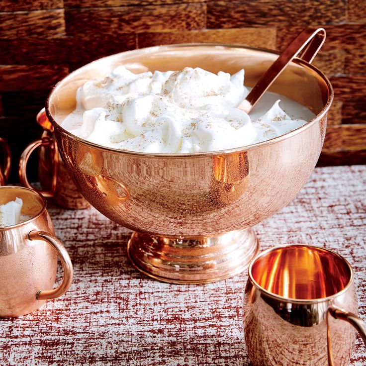 In a classic case of more is more, a beach-ball-size bowl of eggnog turns any house into holiday central.