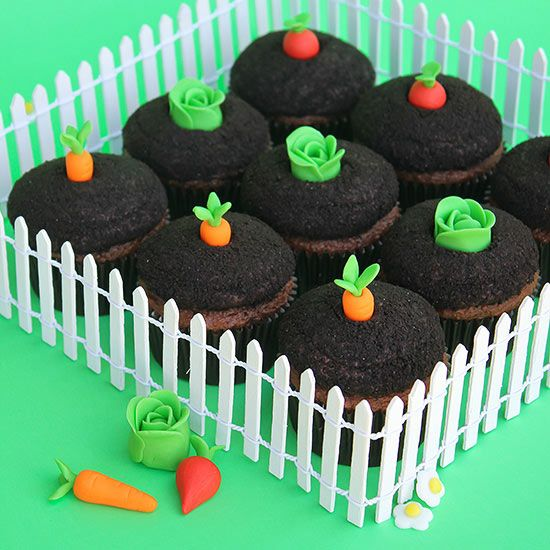 "Garden-Theme Cupcakes Why not celebrate summer by baking a sweet little garden of your own! You can create the adorable little fondant vegetables in just a few easy steps, then ""plant"" them into cookie crumb-coated chocolate icing to give a real gar"