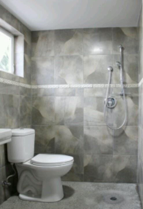 Tiny bathroom. Drain in floor eliminates need for claustrophobic shower walls.