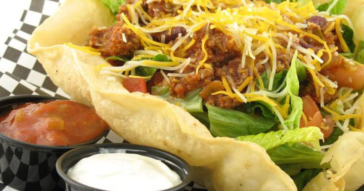 If you've ever ordered a taco salad at a restaurant, it probably arrived at your table in an impressive-looking bowl made from a large tortilla, baked or fried to a crisp and just roomy enough to house the salad's greens and vegetables. Fortunately, these deliciously edible taco salad bowls don't have to remain exclusively restaurant fare: You can...