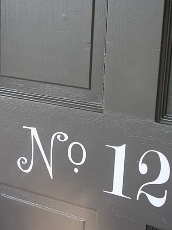 Elegant House numbering. You could do this with a stencil or in vinyl. @Alicia Whitehead, I might need to borrow your cricket ....pretty please:)