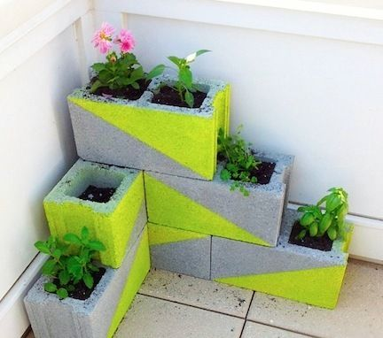 Love the idea for using cement blocks as a corner planter... all with a pop of color!