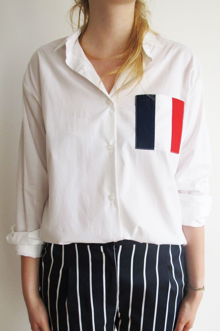 Culture is displayed very well though this outfit. Culture in fashion can be shown through several different ways whether its patterns representing a certain country/culture, colors to represent a country, etc. In this case, France is represented through the flag pattern & colors on the pocket of this shirt.