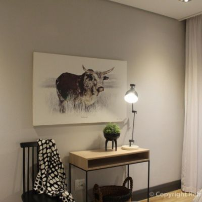 Painting of a Nguni with a dressing table and contemporary chair in Bedroom 2. Refreshed Designs
