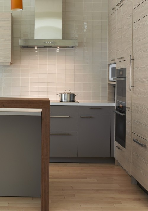 White Glass tiles on wall backsplash, grey cabinets #kitchen