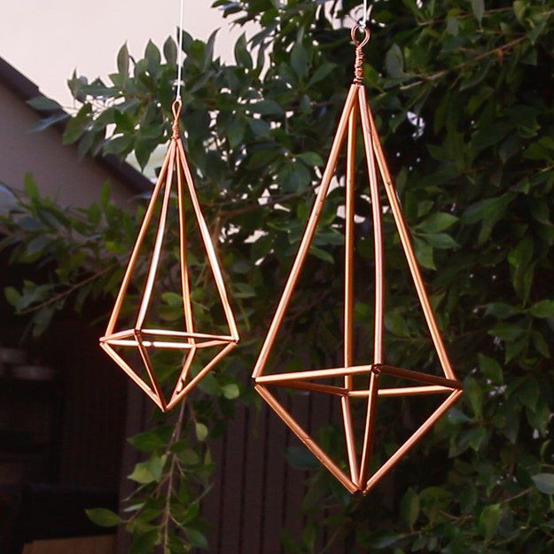 These hangers are surprisingly sturdy, and can be used to hold small plants or ceramic jewelry bowls that measure 3-4 inches in diameter. | These Cheap And Fancy Faux Brass Hangers Will Upgrade Your Space