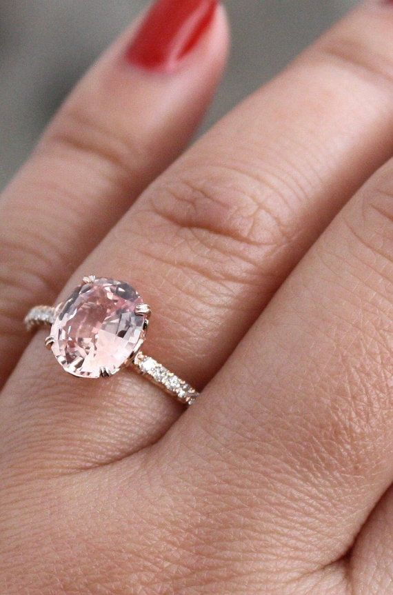 Handmade 14K rose gold diamond engagement ring featuring a solitaire set natural oval brilliant cut peach champagne sapphire measuring 9 x 7.5 mm and weighing 2.33 cts (VS)  Custom lotus inspired gallery is set with round brilliant cut diamonds weighing 0.18 ct. (G/VS2/SI1).  Size 6, can be sized up to 8.  *Ready to ship  SKU 4-100758