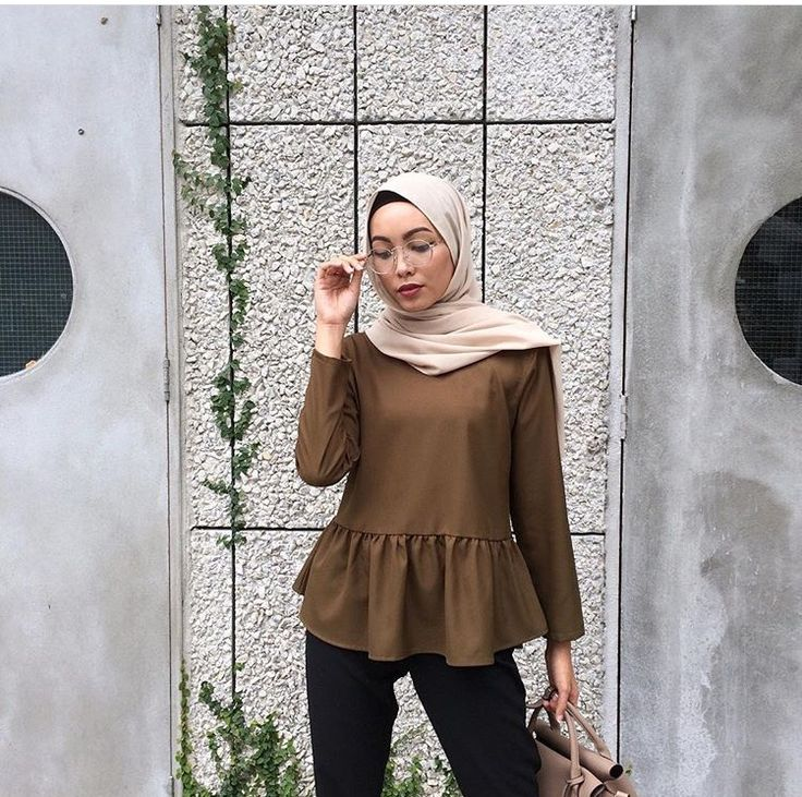 Black trousers, Golden brown top, Nude handbag, Round glasses, Nude hijab. (Pair of nude pumps)