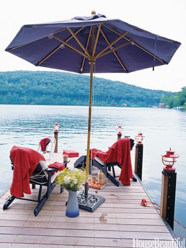 A dock outside of a Connecticut cottage renovated by architect Gil Schafer. Photo: Don Freeman. housebeautiful.com.: Adirondack Chairs, Decor Ideas, Umbrellas, Fall Decor, Lakes Houses, Interiors Design, Camps Style, Places, Lanterns