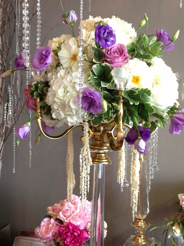 Gold candelabra with flowers