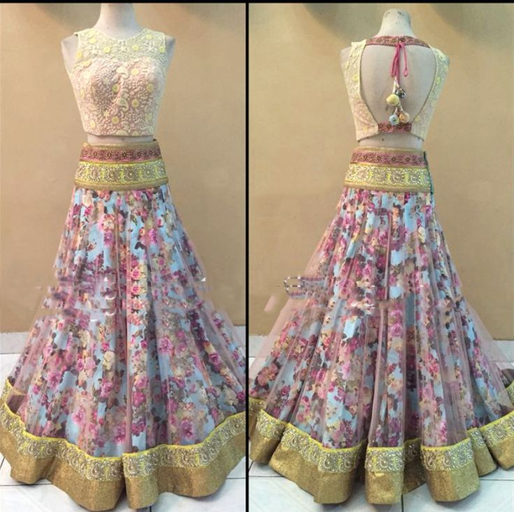 Multi Color Net Lehenga Choli. Bring out the stunning diva in you by wearing this amazing attire embracing attractive designer Lehenga Choli. The perfect ethnic look can be experienced with this outstanding Lehenga Choli. It really goes flawless for any special gathering to lure the audience like never before.