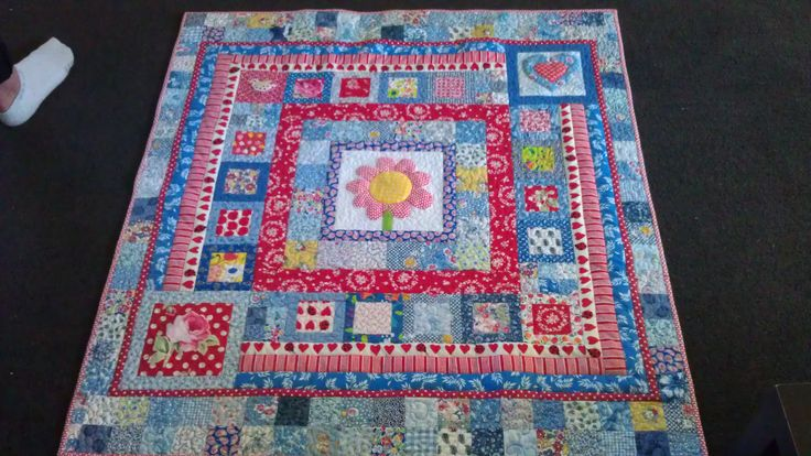 Red white and blue quilt for a baby girl, didn't know her name would be Daisy! I started with the flower block from Material Obsession and just kept adding borders
