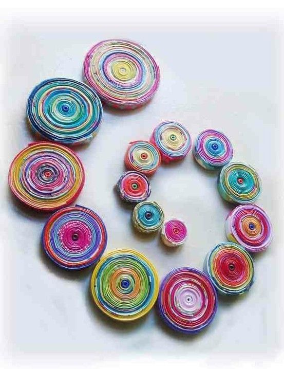Make paper coils from paper scraps like Christmas wrapping paper.  Arrange in patterns such as Christmas tree or use as ornaments on by mariam