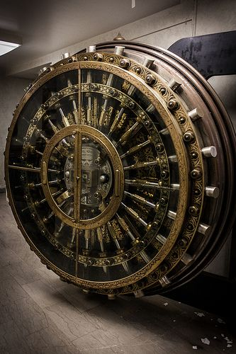 This bank vault door looks almost as intricate as a Swiss timepiece