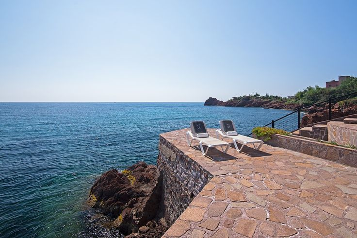 Villa Neptune has been built right on the water's edge at