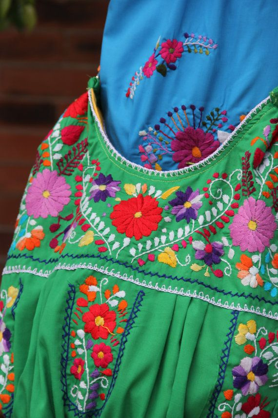 Green with Multi colored hand Embroidered Huipil by CasaOtomi Check out our new website at www.CasaOtomi.com Mexico, Tenango, mexican wedding, textile, mexican suzani, suzani, embroidery, hand embroidered, otomi, otomi, table runner, fiber art, mexican, handmade, original, authetic, textile , mexico casa, mexican decor, mexican interior, frida, kahlo, mexican folk, folk art, mexican house, mexican home, puebla collection, las flores, travel tote, boho, tote, handbag, purse, cushion, pillow