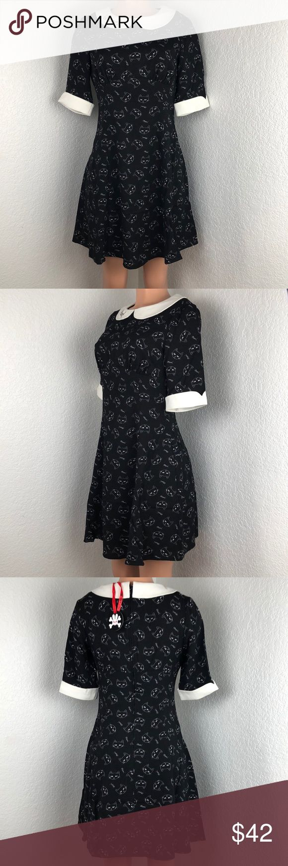 NWT Hell Bunny vintage pinup rockabilly cat dress New with tags vintage inspired black and cream dress. Built-in cream collar says meow! With a cat print and meow written in the print. Cream folded sleeves. Brand new with tags never worn. Size small rockabilly vintage 1940s pinup inspired piece. Retail $82 Hell Bunny Dresses