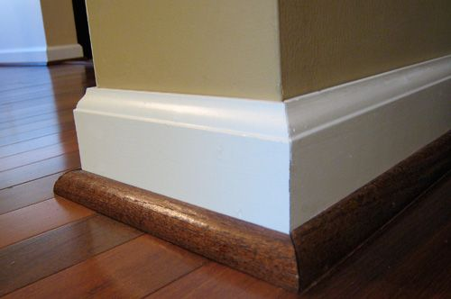 This is important molding...1/4 round stained the same color as floor to avoid marks & scuffs on your white trim!