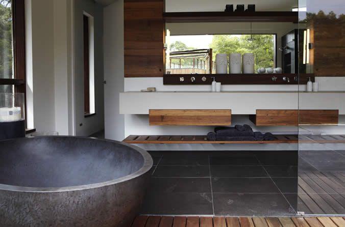 Dark floor tiles white walls & timber features.