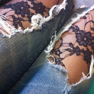 Floral lace under ripped jeans. I was rocking spandex and ripped jeans 20 years ago.
